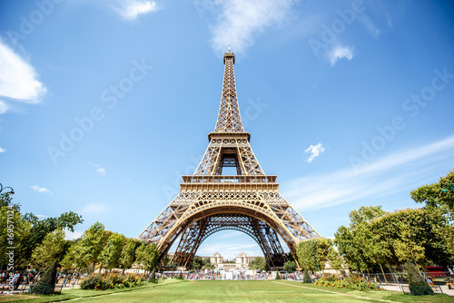 Landscape view from below on the Eiffel tower during the sunny weather in Paris