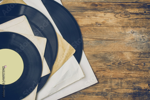 pile of old vinyl records in paper cover