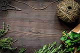 fresh herb frame on dark wooden background top view - 169601540