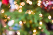 Background of green and red Christmas ornament bokeh