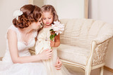 Shy flower girl gives a flower to bride. Wedding. Just married. Kids at the wedding. Wedding hairstyle - 169614345