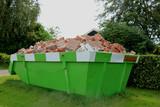 Loaded garbage dumpster - 169615541