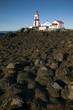 Slippery Rocks Lead to Canadian Lighthouse at Lowest Tide