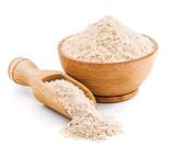 Whole grain buckwheat flour isolated on white