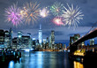 Fireworks over New York City skyline and Brooklyn Bridge