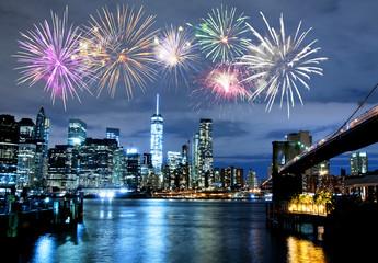 Fireworks over New York City skyline and Brooklyn Bridge