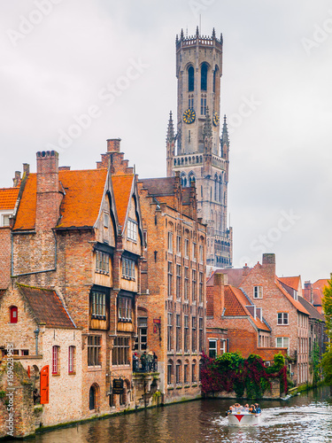 Fotobehang Brugge The Belfry Tower, aka Belfort, of Bruges, medieval bell tower in the historical centre of Bruges, Belgium. Close-up view of the top.