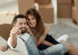 young couple holding the key to a new apartment - 169624593