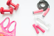 Flat lay of healthy woman accessories and sport items on white background