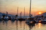 Yachts in port during the sunset