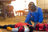 First aid training in the factory industrial. Welder accident in works and fainting in a factory industrial. - 169661926