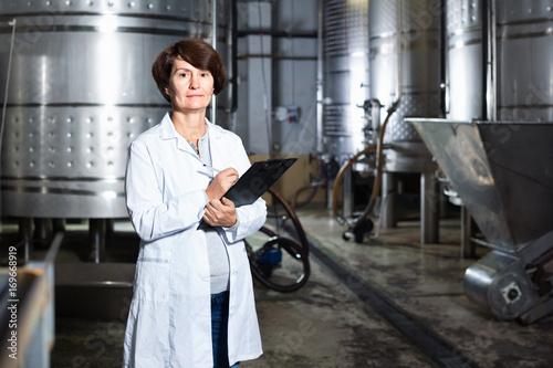 Expert examines equipment at winery