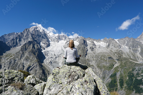 Young woman relaxing in front of Mont Blanc