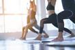 Leinwanddruck Bild - Women exercising in fitness studio yoga classes