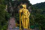 Golden Statue of Shiva and stairs in Batu cave, Malaysia