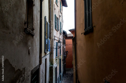 Foto op Canvas Smal steegje Mountain city, Italy, water clouds, architecture