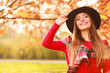 Charming woman walking in autumnal park