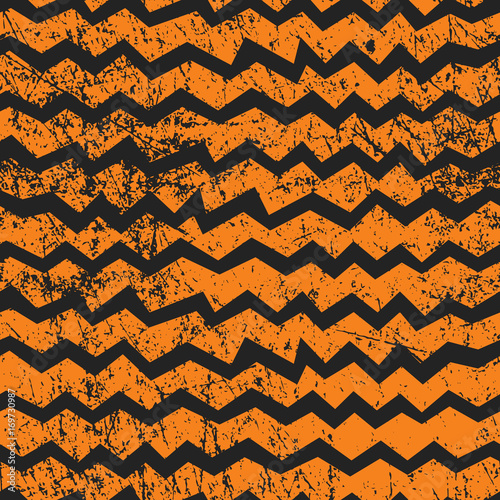 Materiał do szycia Vector seamless Halloween chevron pattern. Black and orange zigzag lines with shabby texture. Good for Halloween cards, polygraphy, stuff.