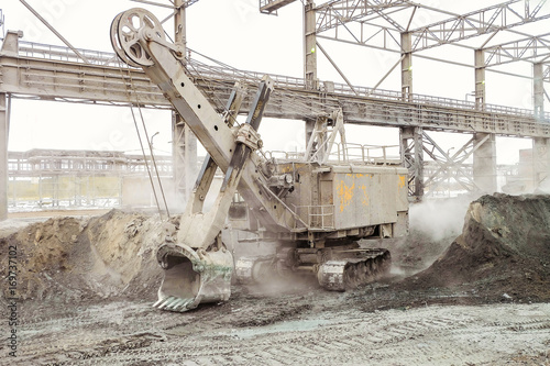 Mining excavator in the industrial outdoors plant shop Poster