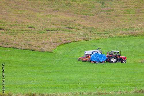 Plakat Tractor with plowes on an Iceland field