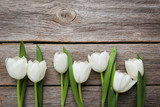 Bouquet of tulips on a grey wooden table