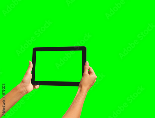 Young girl hand holding a tablet on green screen - 169750174