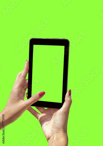 Young girl hand holding a tablet on green screen - 169750191