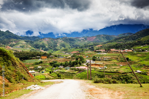 Foto op Plexiglas Rijstvelden green paddy fields around Ma Tra village in the summer, Sa Pa, Vietnam