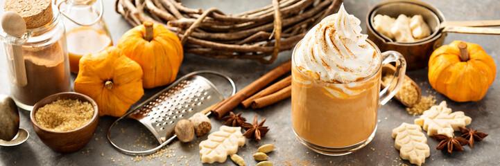 Pumpkin spice latte in a glass mug © fahrwasser
