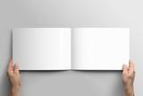 Blank A4 photorealistic landscape brochure mockup on light grey background.  - 169758939