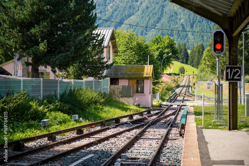 Little mountain train station empty rails in sunny summer day. © frrrantastico