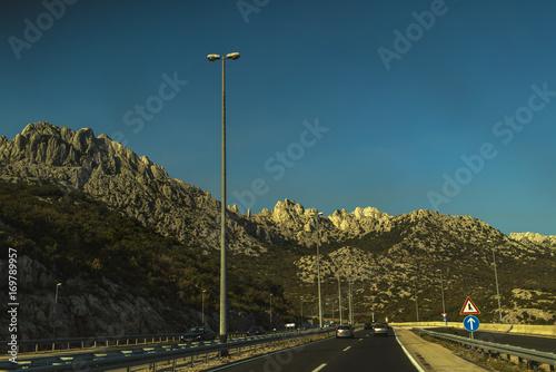 Foto op Plexiglas Groen blauw Landscape with a mountain road on summer day