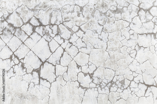 Papiers peints Beton Old concrete wall with cracked white paint