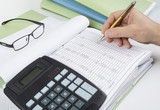 Bookkeeper or financial inspector making report, calculating or checking balance. Audit concept. - 169813387