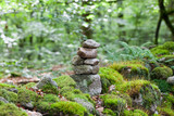A stack of balanced stones in the forest, Limousin, France - 169827320