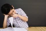 7 years old Asian boy is feeling sad