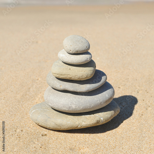 Foto op Canvas Zen Zen image, stones pyramid in sand