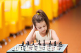 girl are playing at a chess table