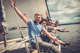 Happy friends resting on a yacht - 169864134