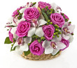 bouquet of pink roses  and lilias in basket  on white background