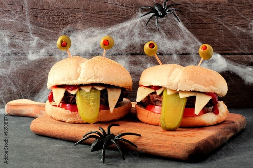 Halloween monster hamburgers on a paddle board with spider web background - 169881176