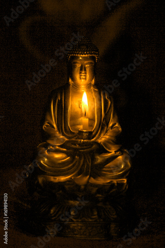 Fotobehang Boeddha Bronze Buddha statue in darknes with candle