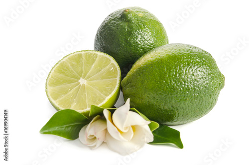 green limes with half of  juicy lime and beautifull flower isolated on white bac Poster