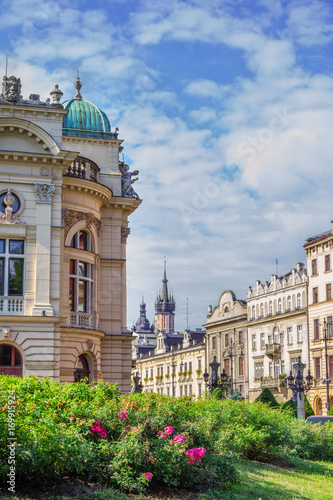 Foto op Plexiglas Krakau Cityscape of Krakow old town, part view of Theater building, Szpitalna street and town hall on a sunny summer day with blue sky and blooming tea rose bushes