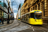 Light rail yellow tram in the city center of Manchester, UK - 169922750