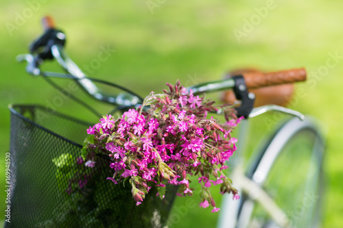 Fotobehang Fiets close up of fixie bicycle with flowers in basket