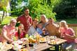 happy family having dinner or summer garden party