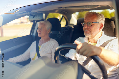 Leinwandbild Motiv happy senior couple driving in car