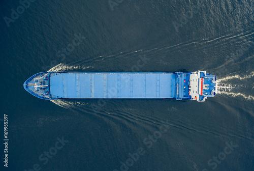Fotobehang Zeilen Aerial view of general cargo ship in open sea