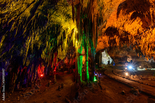 Papiers peints Marron Stalactite stalactites with color lighting in cave